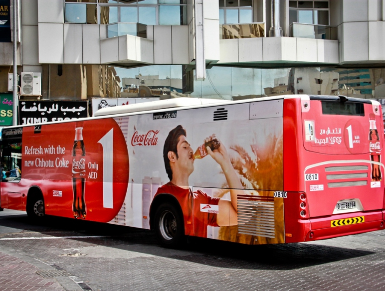Coca-Cola advertising on bus body